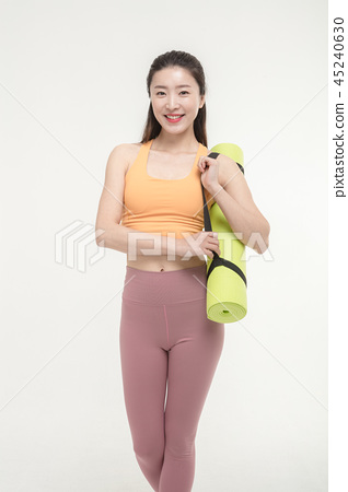 Korean woman with yoga mat 45240630