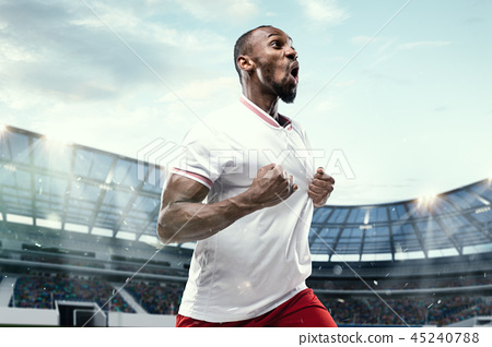 The football player in motion on the field of stadium 45240788