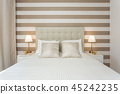 Modern bedroom with pillows and a bed for tourists. Frontally. 45242235