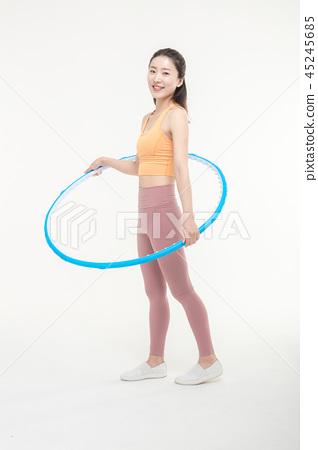 Korean woman exercising hula hoop 45245685