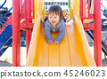Toddler boy playing on the playground 45246023