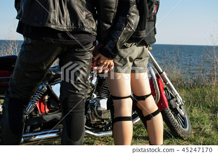 bikers in love in leather clothes near the bike 45247170