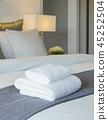 Clean towel on bed in modern interior bedroom 45252504