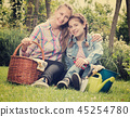 woman and teen with gardening tools 45254780