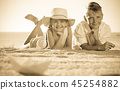 two kids lying beach 45254882