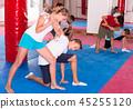 Kids exercising self-defense movements 45255120