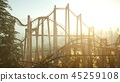 old roller coaster at sunset in forest 45259108