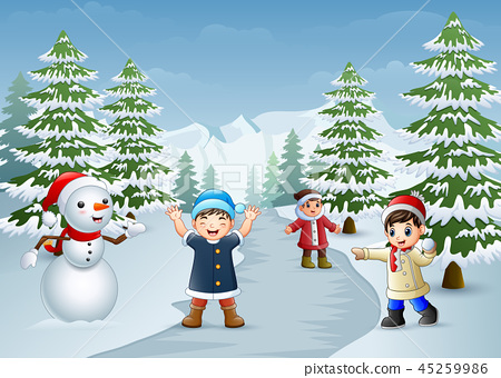 Happy kids playing with a snowman in winter 45259986
