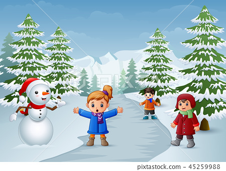 Happy kids playing with a snowman in winter 45259988