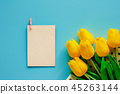 Artificial yellow tulips with white paper card 45263144