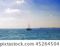 Dark silhouette of ship in sea at sunset 45264504