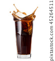 Splash in high glass of cola 45264511