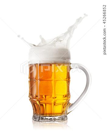 Foam splash in the faceted beer mug 45266852