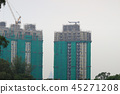 a luxury apartments under construction with crane 45271208