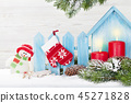 Christmas candles, snowman toy and fir tree 45271828