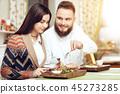 Romantic dinner happy men and women in restaurant 45273285