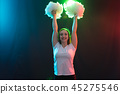 Happy cheerleader dancing with pom-poms and looking at camera 45275546
