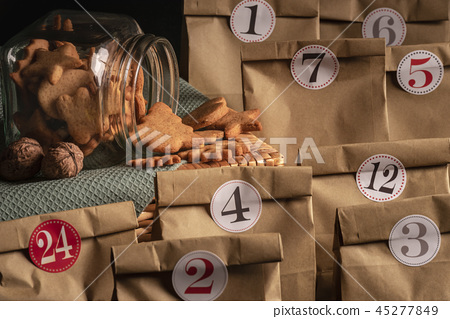 Jar with cookies and advent calendar 45277849