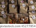 Numbered paper bags with cookies and nuts 45277854