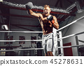 Boxer. Confident young boxer on the boxing ring 45278631
