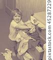 Baby girl chooses dress 45287229