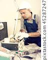 Worker builder searching tools for repair 45287247