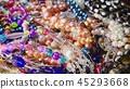 Heap of jewelry, beads, rings and bracelets 45293668