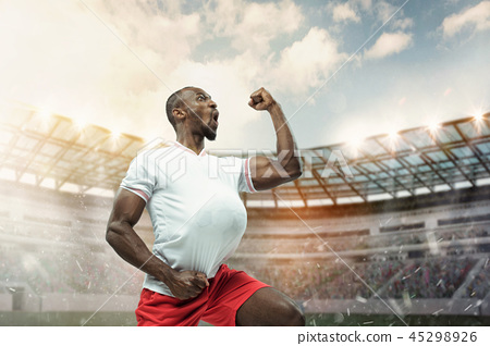 The football player in motion on the field of stadium 45298926