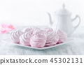 lovely pastel rose meringues, zephyrs, marshmallows and a coffee pot on the wooden vintage table 45302131