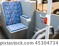 stop button modern and comfortable interior of the city bus  45304734