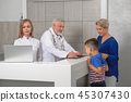 Mother and son looking at analysis in hospital. 45307430