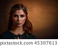 Crop of beautiful princess in silver tiara with emeralds.  45307613
