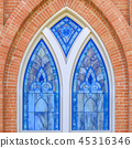 Beautiful stained glass window of a brick building 45316346