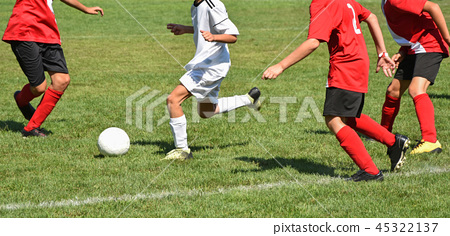 Young soccer players in action 45322137