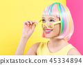 Woman wearing sunglasses in a colorful wig 45334894