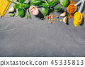 Ingredients for cooking placed on dark background. 45335813
