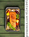 Baking dish with fresh raw salmon steak, vegetables  and seasoni 45341945