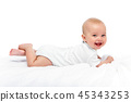 happy beautiful baby girl in white body suit 45343253