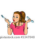 woman with fork and spoon 45347040