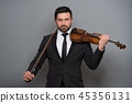 Musician man playing the violin. Musical instrument on performer 45356131