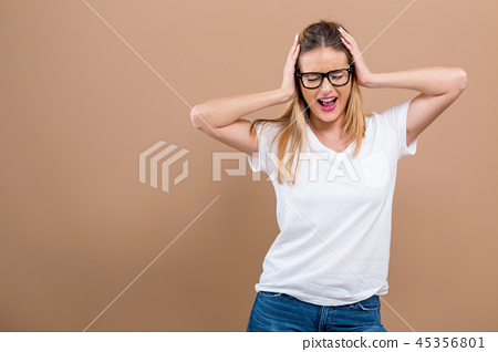 Young woman blocking her ears 45356801