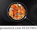 chicken thighs on frying pan 45357963