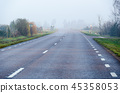 Foggy road by morning sunshine 45358053