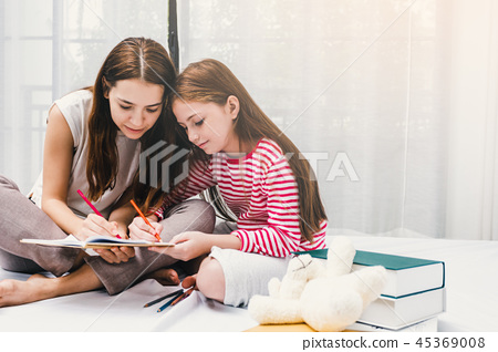 Family Happy Mother and daughter drawing 45369008