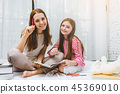 Family Happy Mother and daughter drawing 45369010