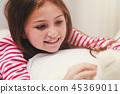 Little girl playing teddy bear 45369011