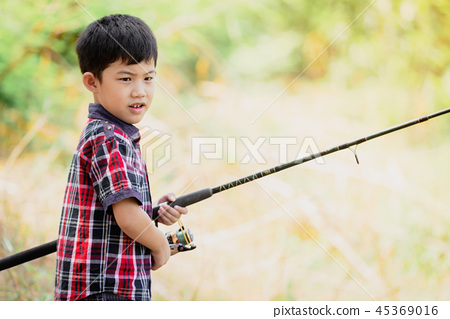 Asian young cute little boy fishing in natural 45369016