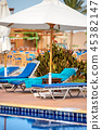 Swimming Pool with Deck Chairs and Beach Umbrellas 45382147