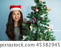 happy Asian Chinese girl at Christrmas tree 45382945