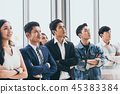 Asian Businesspeople are standing up at the office 45383384